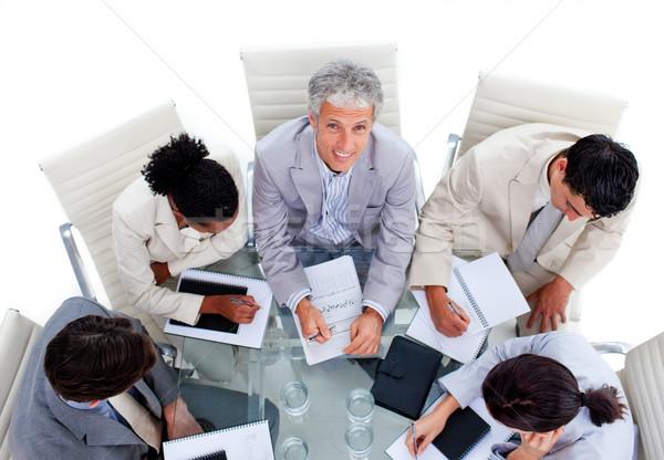Sokoldalú üzleti csoport megbeszélés magasról fotózva iroda üzletember Stock fotó © wavebreak_media