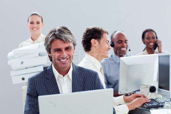 肖像 笑みを浮かべて ビジネスチーム 作業 オフィス コンピュータ ストックフォト © wavebreak_media