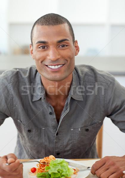 Portrait of ethnic man dinning Stock photo © wavebreak_media