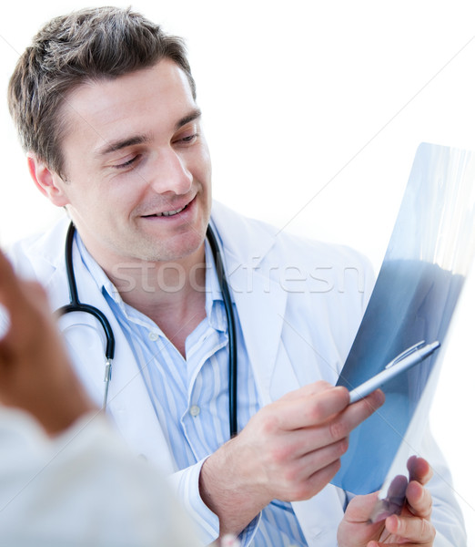 Portrait of a charming male doctor showing the results to his pa Stock photo © wavebreak_media