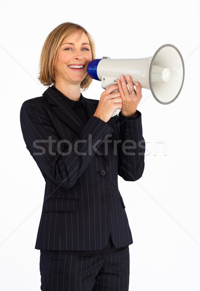 Businesswoman with a megaphone smiling at the camera Stock photo © wavebreak_media
