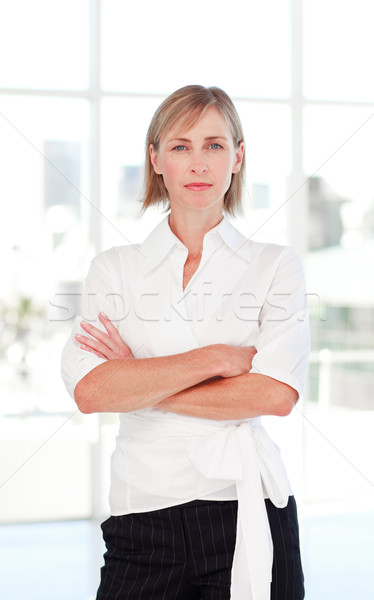 Serious businesswoman with folded arms Stock photo © wavebreak_media