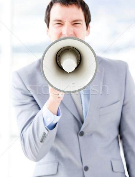 Retrato nervioso empresario megáfono oficina hombre Foto stock © wavebreak_media