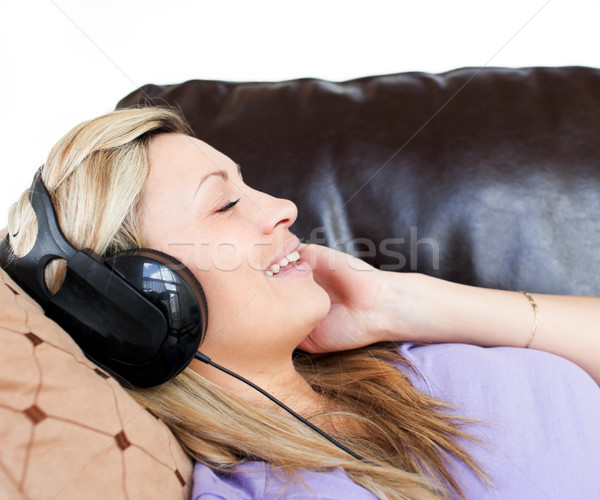 Glimlachende vrouw hoofdtelefoon sofa gelukkig rock leuk Stockfoto © wavebreak_media