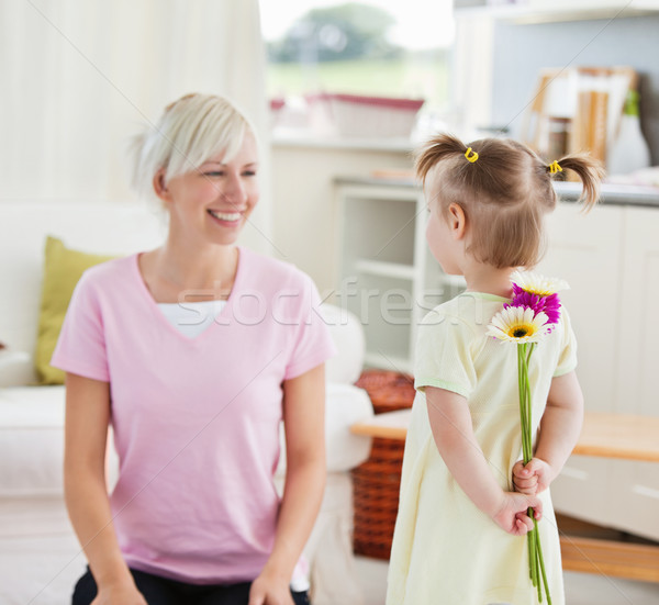 Pretty woman get surprise by her daughter in living room Stock photo © wavebreak_media