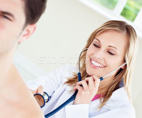 Sorridente médico paciente escritório trabalhar médico Foto stock © wavebreak_media