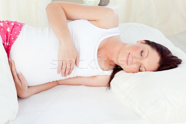 Zwangere vrouw slapen bed home baby gelukkig Stockfoto © wavebreak_media