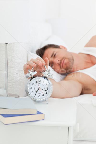 Infeliz hombre cama hasta dormitorio casa Foto stock © wavebreak_media