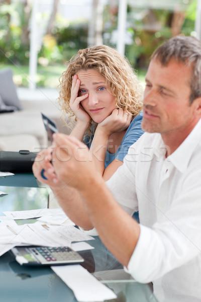 Man cutting up his credit card Stock photo © wavebreak_media