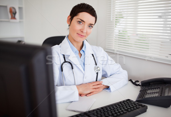 Serious female doctor looking at the camera in her office Stock photo © wavebreak_media