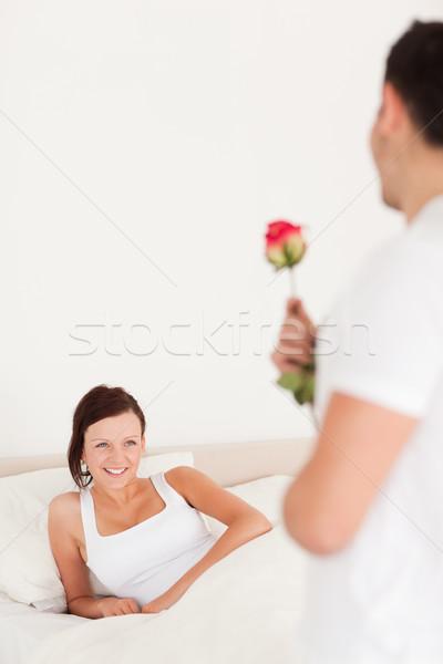 Jóképű fickó rózsa barátnő hálószoba ház Stock fotó © wavebreak_media