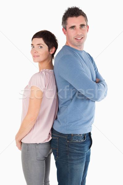 Back to back couple against a white background Stock photo © wavebreak_media