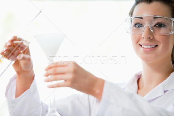 ученого жидкость воронка лаборатория глаза Сток-фото © wavebreak_media
