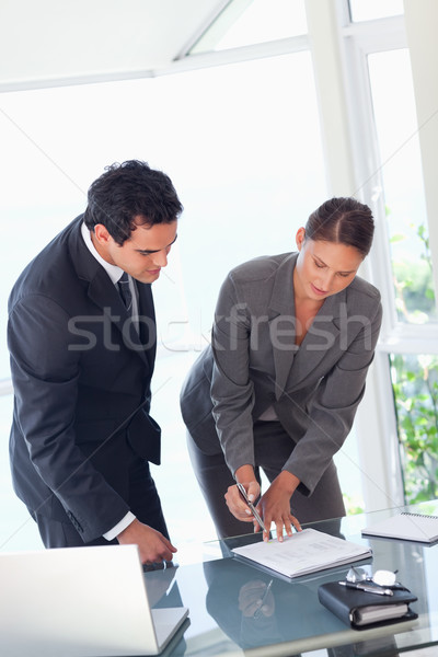 Young businesswoman showing partner where to sign Stock photo © wavebreak_media