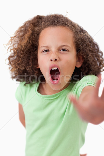 Portrait of an angry girl saying stop with her hand against a white background Stock photo © wavebreak_media