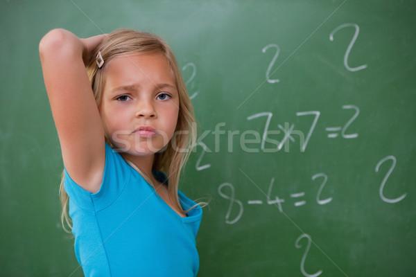 Studentessa pensare indietro testa lavagna studente Foto d'archivio © wavebreak_media
