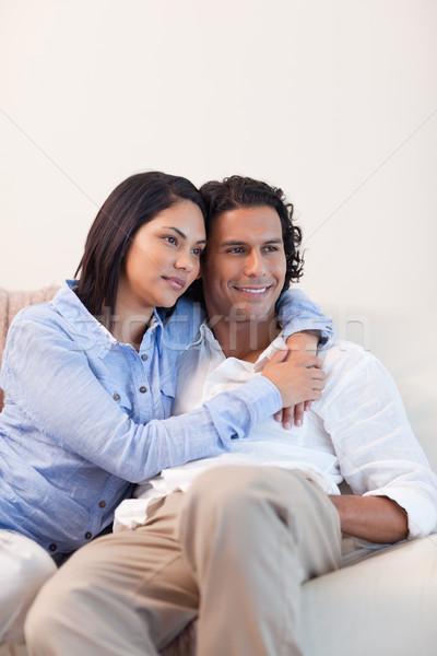 Young couple on the sofa embracing Stock photo © wavebreak_media