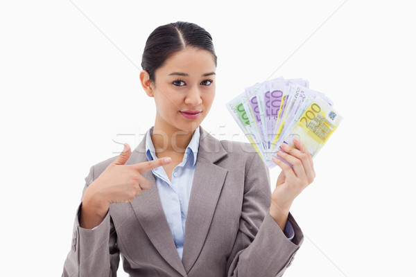 Businesswoman holding bank notes against a white background Stock photo © wavebreak_media