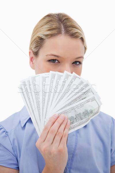 Mujer ocultación cara detrás dinero blanco Foto stock © wavebreak_media