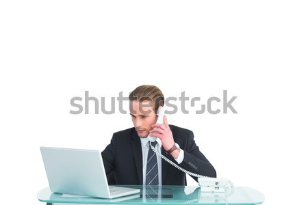 Sitting woman having trouble with notebook against a white background Stock photo © wavebreak_media