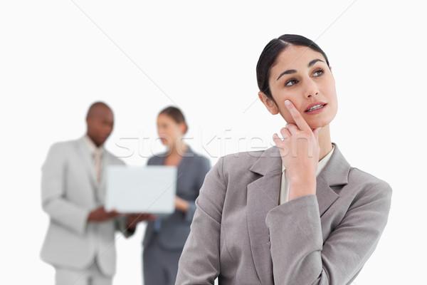 Imprenditrice pensieri colleghi dietro bianco business Foto d'archivio © wavebreak_media