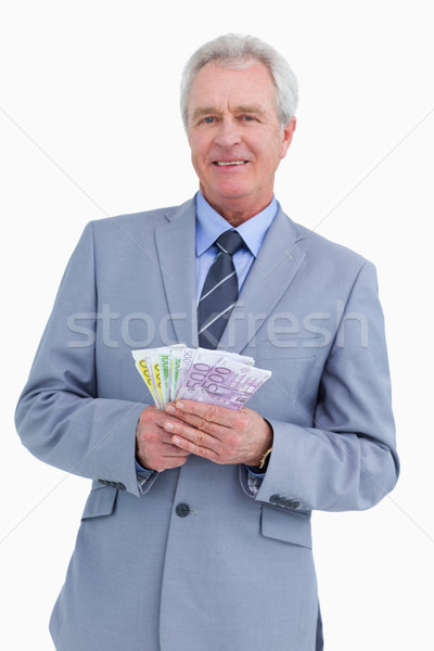 Smiling mature tradesman with bank notes in his hands against a white background Stock photo © wavebreak_media