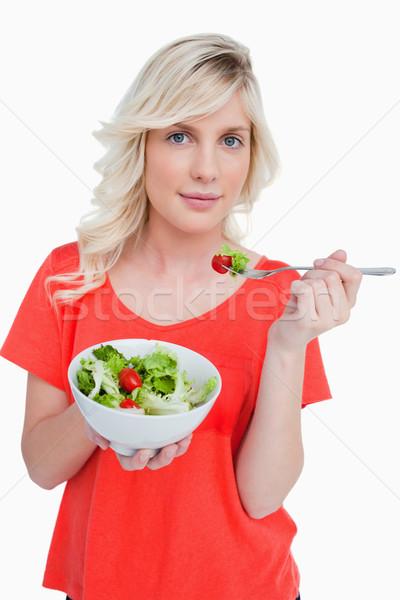 Jovem mulher loira alimentação vegetal salada branco Foto stock © wavebreak_media