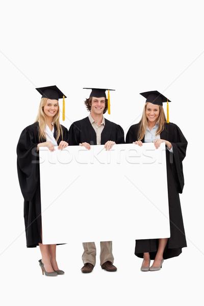 Três estudantes pós-graduação robe Foto stock © wavebreak_media