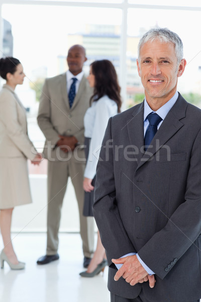 Mature manager standing upright with his hands crossed Stock photo © wavebreak_media