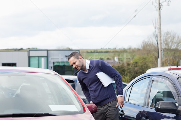 Man looking at a car while leaning outdoors Stock photo © wavebreak_media