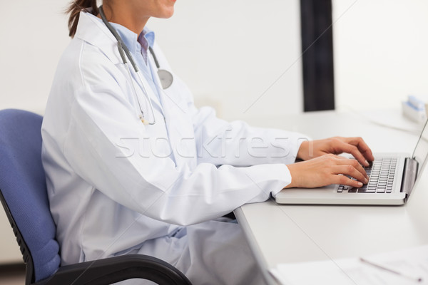Doctor using a laptop in a medical office Stock photo © wavebreak_media