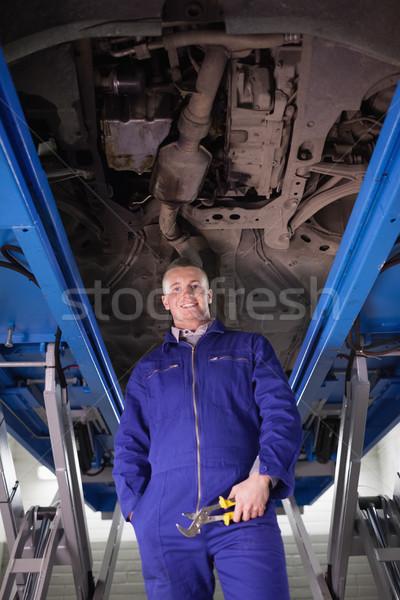 Mechaniker stehen up unterhalb Auto Garage Stock foto © wavebreak_media