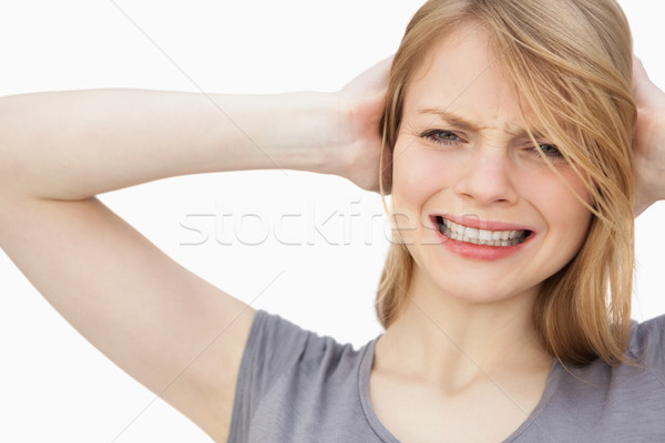 Woman with hand behind her head against a white background Stock photo © wavebreak_media