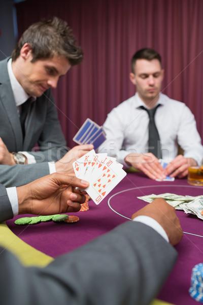 Man at poker table has royal flush in poker game in casino Stock photo © wavebreak_media