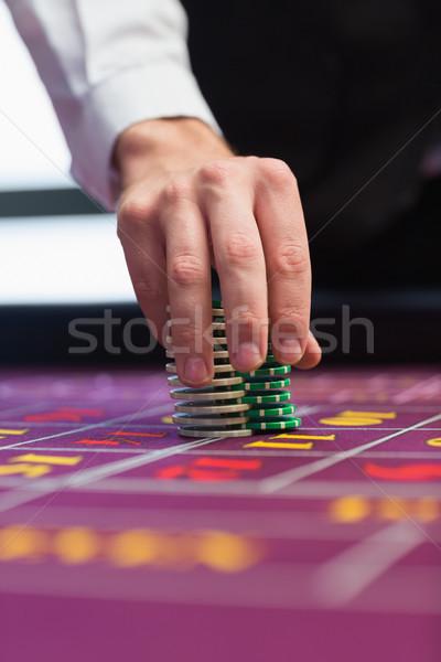 Revendeur puces table casino jeu riche Photo stock © wavebreak_media