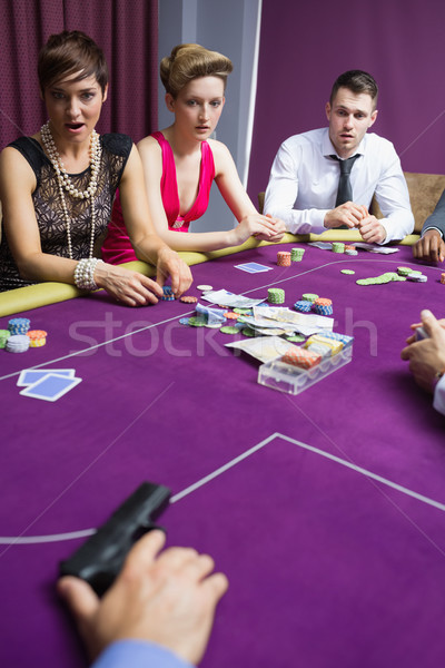 People shocked at gun on poker table Stock photo © wavebreak_media