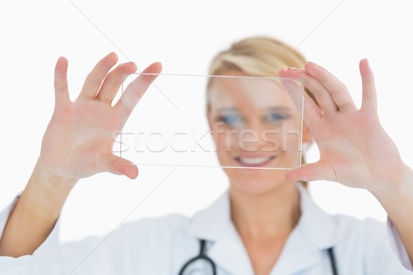 Smiling doctor in labcoat holding up clear pane Stock photo © wavebreak_media
