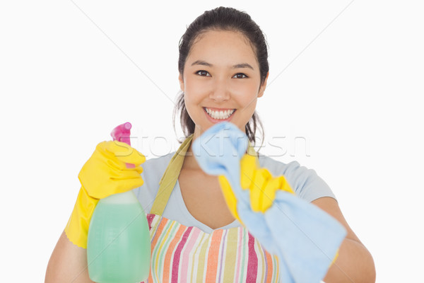Smiling woman in apron and gloves wiping in front of her Stock photo © wavebreak_media