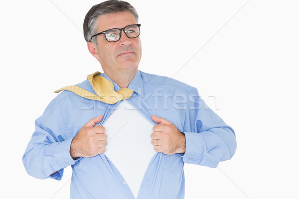 Serious man with glasses is pulling his shirt with his hands like a superhero Stock photo © wavebreak_media