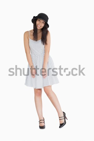 Smiling woman wearing hat and polka dot dress Stock photo © wavebreak_media