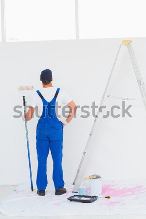 Cleaning woman wiping up the floor on the white background Stock photo © wavebreak_media