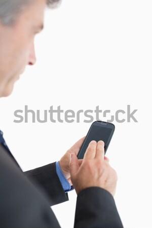 Primo piano donna d'affari cellulare bianco telefono suit Foto d'archivio © wavebreak_media