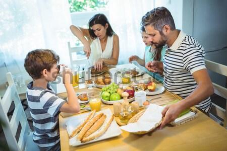 Mother serving vegetables to daughter at dinner Stock photo © wavebreak_media