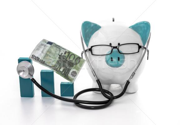 Spaarvarken bril stethoscoop luisteren Blauw Stockfoto © wavebreak_media