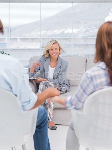 Smiling therapist speaking a couple Stock photo © wavebreak_media