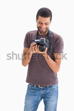 Stylish man with camera around his neck Stock photo © wavebreak_media