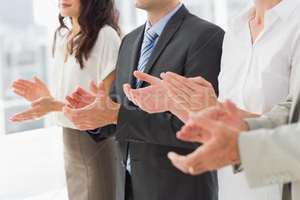 Business team standing in a row applauding Stock photo © wavebreak_media