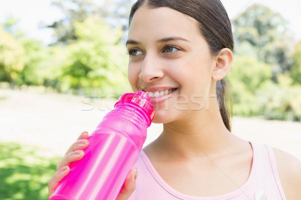 Sporty woman drinking water Stock photo © wavebreak_media