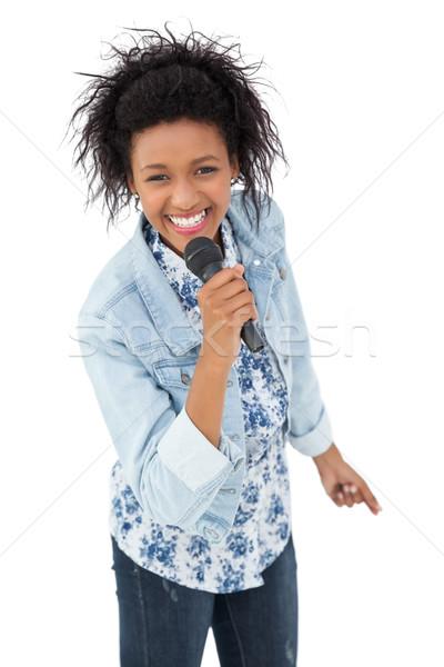 Portré fiatal nő énekel mikrofon fehér jókedv Stock fotó © wavebreak_media