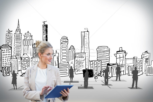 Blonde businesswoman using tablet pc with cityscape  Stock photo © wavebreak_media